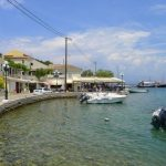 Kassiopi harbour by Vera